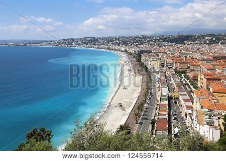 NICE, FRANCE - APRIL 30, 2015: Beach and cityscape of Nice on April 30, 2015 in Nice, France. It is a popular tourist resort on French Riviera.