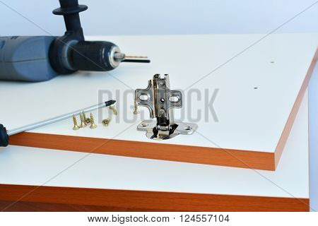 Hinge assembly on white kitchen cabinet door