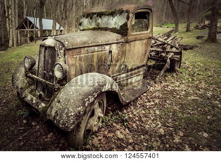 Gatlinburg, Tennessee, USA. March 25, 2016 - A 1930's Dodge pick up truck abandoned on a farm with it's load of logs still in place.