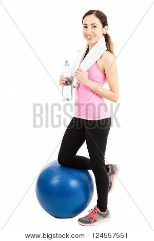 Young woman taking a break from exercise during pilates. Isoalted on white background.