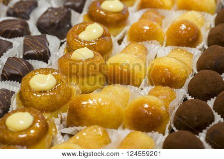 variety of handmade pastry filled with cream