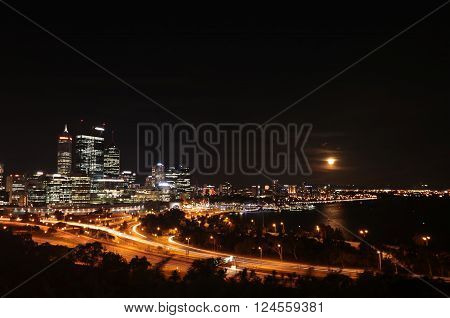 Night scene of Perth city center with a rising full moon ** Note: Soft Focus at 100%, best at smaller sizes