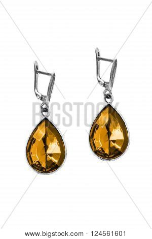 Faceted amber silver earrings on white background
