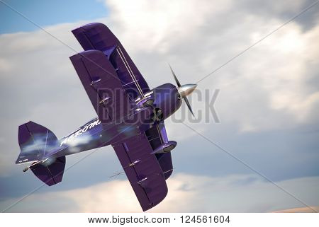 ANKARA/TURKEY-OCTOBER 11, 2008 : Airshow pilot Ali Ismet Ozturk and his purple violet PITTS aircraft over the Etimesgut Turkkusu Airport during the air fest of Turkish Air Association-THK. October 11, 2008-Ankara/Turkey