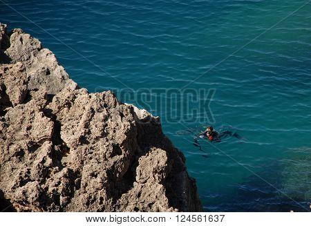 ANTALYA/TURKEY-OCTOBER 20, 2014-SCUBA diver in the sea  near the Kaleici coast. October 20, 2014-Antalya/Turkey