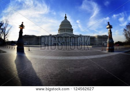 United State Capitol Building for congress with american flag flowing in breeze and columns in background