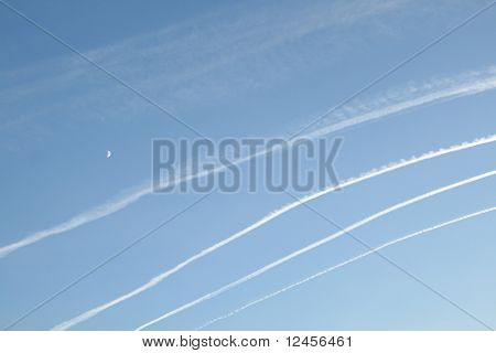blue sky and airplane lines
