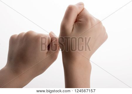 Clenched fists gesture on a white background