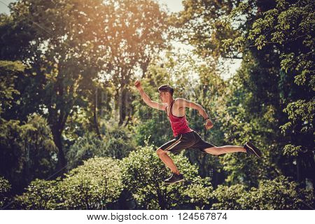 Action shot of relay race  runner in mid-air