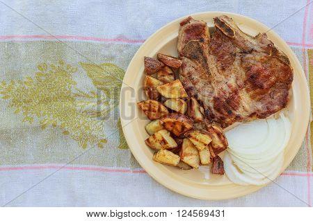 Pork Steak Potato In Village White Onion