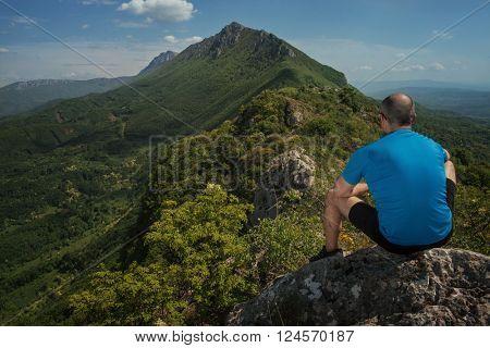 Sport man resting and enjoying in mountain