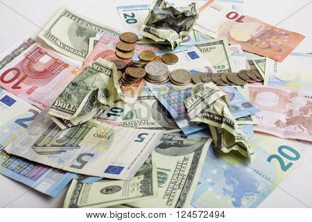 Cash on table isolated: dollars, euro, rubl broken money. All in mess, global crisis concept close up