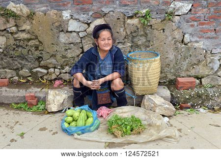 LAO CAI, VIETNAM, July 14, 2015 Hmong women. highland Lao Cai, selling vegetables