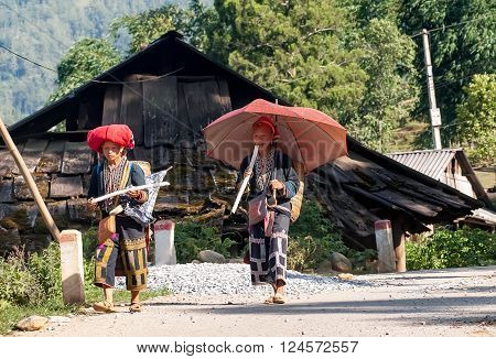 LAO CAI, VIETNAM, March 12, 2016 two women ethnic DAO, on the way home