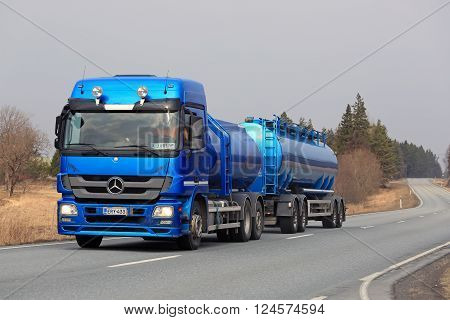 SALO, FINLAND - MARCH 28, 2016: Blue Mercedes Benz Actros tank truck moves along road. Daimler AG produced 3 versions of the Actros before introducing the New Actros in 2012.
