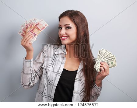 Happy Business Woman Thinking That Currency To Choose, Dollars Or Rubles, Holding Money In Different