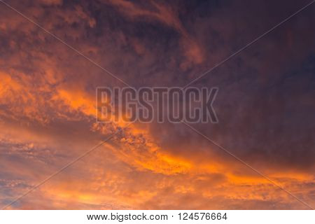 Dramatic fiery sky on sunset with color clouds