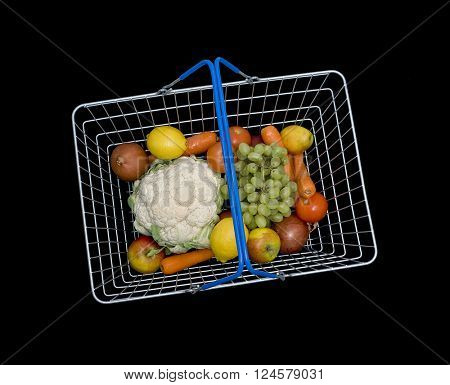 Shopping basket with fruit and vegetables