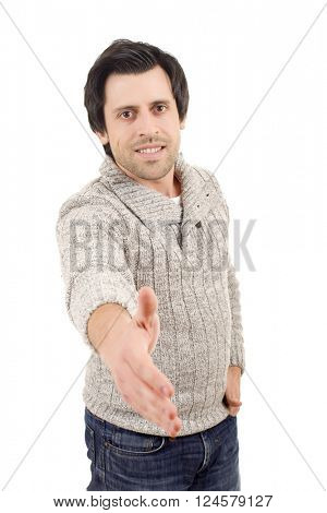 young casual man offering to shake the hand, isolated