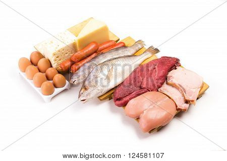 Group of important proteins meats fish dairy eggs white meat on a white background Shot from above