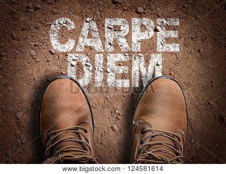 Top View of Boot on the trail with the text: Carpe Diem