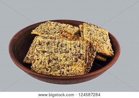 cookies from flaky unleavened dough with sesame seeds and sunflower on a white background.