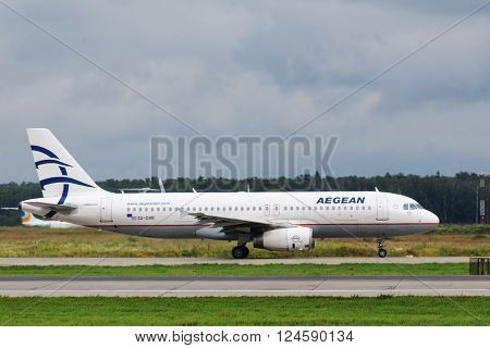 DOMODEDOVO RUSSIA - JULY 20: Aircraft operated by Aegean Airlines ready to take off at Moscow airport in Domodedovo on July 20 2013. The company in its fleet has 25 aircraft Airbus-A320