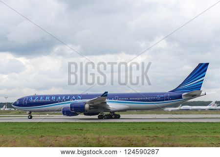 DOMODEDOVO RUSSIA - JULY 20: Azerbaijan Airlines Airbus A340 taxiing at Moscow airport in Domodedovo on July 20 2013. Azerbaijan Airlines is the national carrier of Azerbaijan.