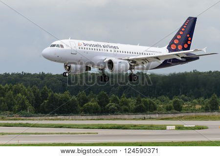 DOMODEDOVO RUSSIA - JULY 20: Aircraft operated by Brussels Airlines landing in Moscow airport Domodedovo on July 20 2013. The company in its fleet has 16 aircraft Airbus-A319