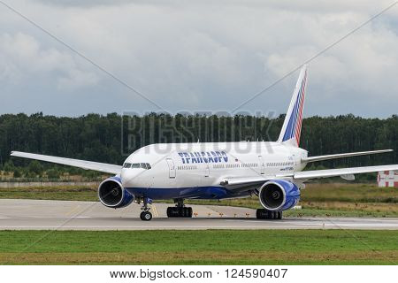 DOMODEDOVO RUSSIA - JULY 20: Aircraft operated by Transaero Airlines ready to take off at Moscow airport in Domodedovo on July 20 2013. The company in its fleet has 9 aircraft Boeing-777-200ER