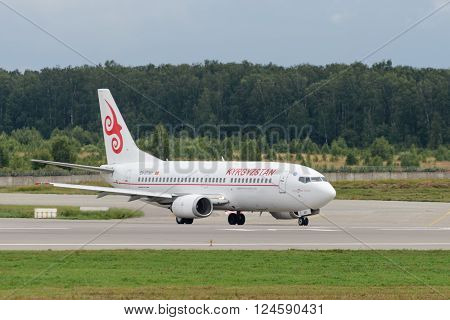DOMODEDOVO RUSSIA - JULY 20: Aircraft operated by Kyrgyzstan Aircompany ready to take off from Moscow airport Domodedovo on July 20 2013. The company in its fleet has 4 aircraft Boeing-737