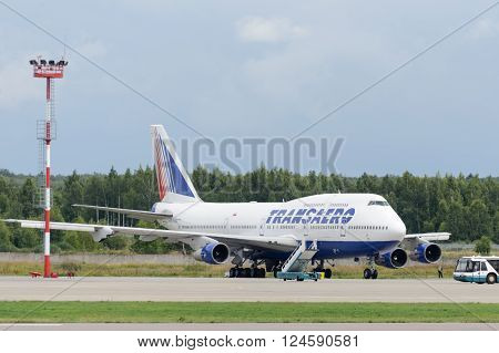 DOMODEDOVO RUSSIA - JULY 20: Aircraft operated by Transaero Airlines pending repair of the engine in Moscow airport Domodedovo on July 20 2013. The company in its fleet has 21 aircraft Boeing-747