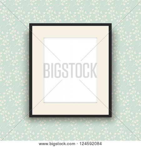 Blank picture frame hanging on vintage style wallpaper