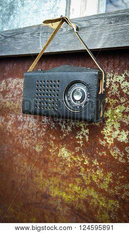 The Old vintage radio on brown background