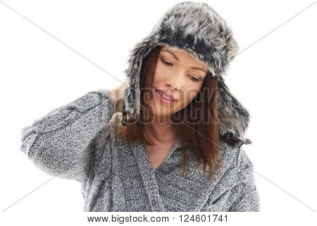 Woman wearing winter fur hat isolated over white background