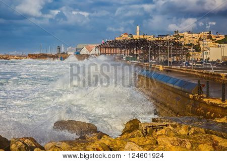 New Quay in the Old Jaffa, Israel. Whole gale in the Mediterranean Sea. Huge foamy waves fight about the coast