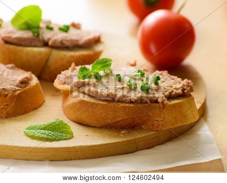 Sandwich with paste and green onions in a glass .