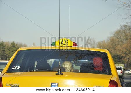BUCHAREST ROMANIA - NOV 28 2008: Yellow taxi cab with huge antennas wating in traffic jam on the Bucharest boulevards
