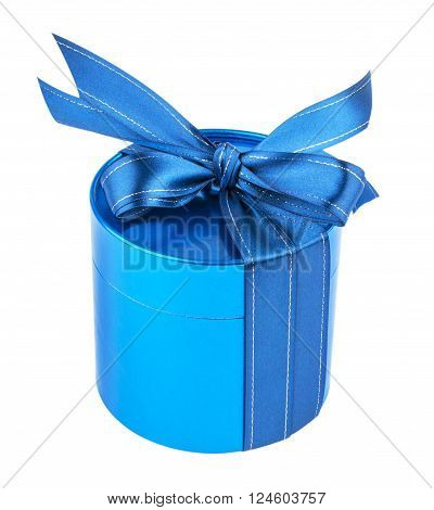 Round gift box tied with a blue ribbon with a bow on top. Blue pearl color. Isolated on white background.