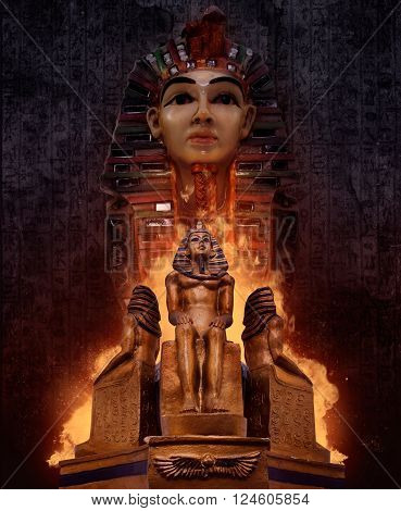 Composition of ancient egyptian pharaoh`s tomb statues with fire & symbolic rusty walls on background.