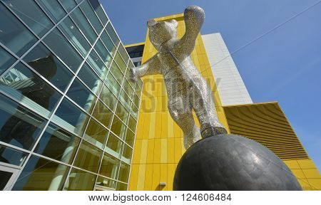 MONTREAL CANADA 29 03 2016: Quebec artist Michel Saulnier creates larger than life, whimsical bear sculpture (Je suis la!) I'am here! for the new Montreal Children's Hospital.