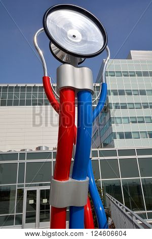 MONTREAL CANADA 03 29 2016: Giant sculputre (Prendre le pouls) take the pulses by Cooke-Sasseville the stethoscope symbolizes the relationship of trust between physician and patient.