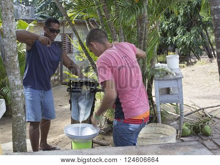 Manaca Iznaga Cuba - January 2 2016: Valle de Los Ingenios sugar cane juice preparation by two cuban guys