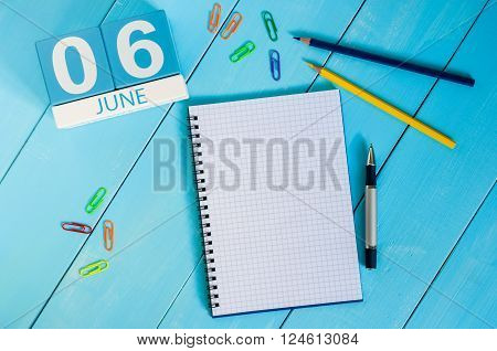 June 6th. Image of june 6 wooden color calendar on blue background. Summer day, empty space for text.