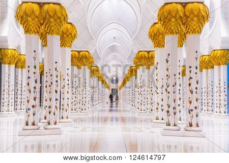 ABU DHABI, UAE - MARCH 27, 2014: Columns of Sheikh Zayed Grand Mosque in Abu Dhabi, UAE. This is the largest mosque in the United Arab Emirates and the eighth largest mosque in the world.