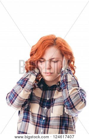 woman with head ache holding her head. Isolated over white background