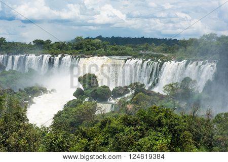Spectators watching Iguazu Falls from observation deck