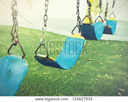Swing Playground In The Green Grass Park