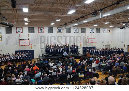 JOLIET, ILLINOIS / UNITED STATES - DECEMBER 10, 2014: The sixth, seventh, and eighth grade choirs sing at a Christmas concert at Drauden Point Middle School.
