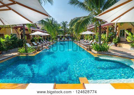 beautiful swimming pool in public tropical resort , Phuket, Thailand.